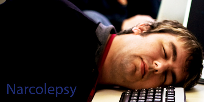 man with narcolepsy asleep at work